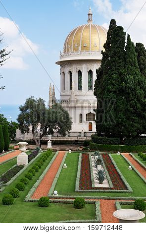 HAIFA ISRAEL - CIRCA SEP 2016: Bahai temple with golden dome trees and fir-trees near it