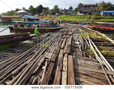 KANCHANABURI THAILAND - NOVEMBER 25: wooden raft near the old wooden Mon Bridge in Sangkhla Buri on November 25 2016 in Kanchanaburi Thailand