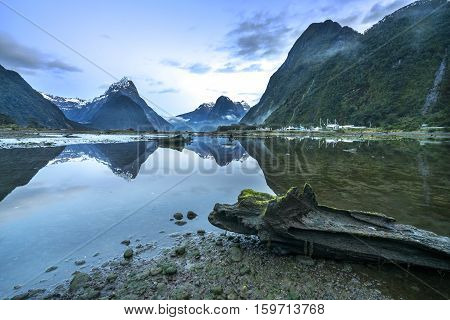 Lake with mountain reflection at Milford Sound Fiordland, New Zealand