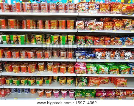 CHIANG RAI THAILAND - NOVEMBER 26: various brand of instant noodles in packaging for sale on supermarket stand or shelf in Seven Eleven on November 26 2016 in Chiang rai Thailand