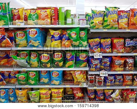CHIANG RAI THAILAND - NOVEMBER 26: various brand of potato chips and snacks in packaging for sale on supermarket stand or shelf in Seven Eleven on November 26 2016 in Chiang rai Thailand