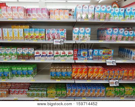 CHIANG RAI THAILAND - NOVEMBER 26: various brand of milk and dairy products in packaging for sale on supermarket stand or shelf in Seven Eleven on November 26 2016 in Chiang rai Thailand