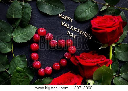 inscription Closeup of Valentine's day, cherry heart-shaped, red roses, rings