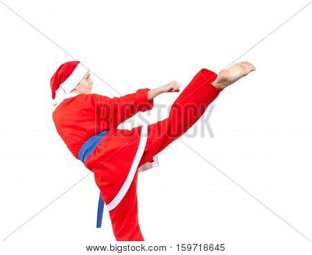 Roundhouse kick the sportswoman beats in a suit of Santa Claus