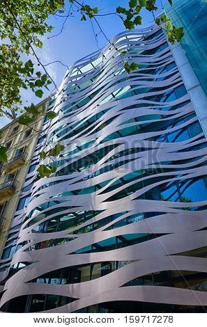 Modern glass and iron facade of Passeig de Gracia in Barcelona, summer Spain