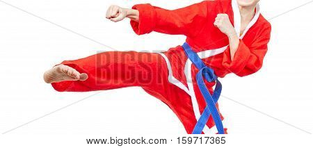 Karateka with a blue belt is beating kick leg