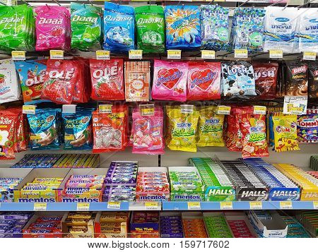 CHIANG RAI THAILAND - NOVEMBER 27: various brand of candy in packaging for sale on supermarket stand or shelf in Seven Eleven on November 27 2016 in Chiang rai Thailand.