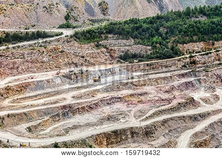 Open quarry for stone extraction. Quarry. Panorama aerial view. The problem of environmental pollution.