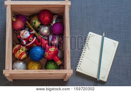 Wooden box with Christmas toys notepad and pencil.