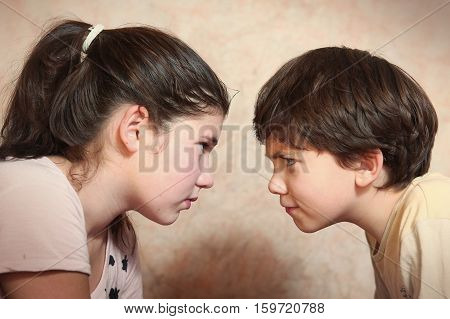 brother and sister after quarreling argue close up portrait