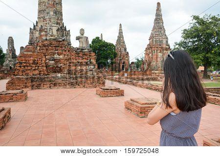 Woman Praying In Front Of Buddha In Ayutthaya Thailand