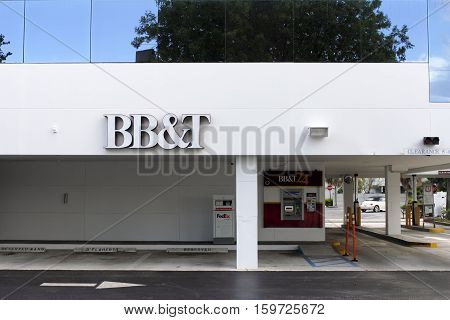 Fort Lauderdale FL USA - April 24 2016: BB&T sign on bank building with ATM and drive through lanes. BB&T bank facade with ATM and drive through banking signs