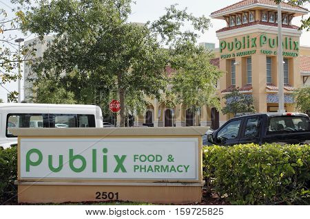 Fort Lauderdale FL USA - April 30 2016: Two Publix Food & Pharmacy signs with a Publix grocery store. Publix grocery signs and supermarket on a sunny day