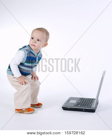 photo of cute boy with laptop on white