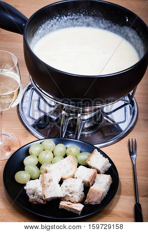 Cheese fondue with bread wine and grapes