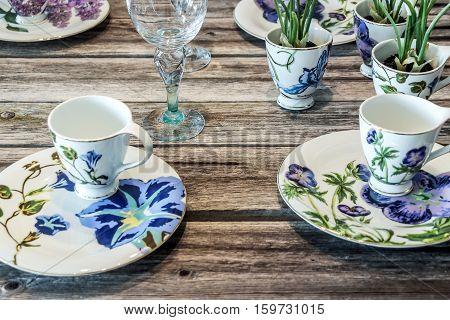 blue flowery pattern cutlery on wooden table