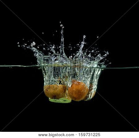 splashing, fresh fruit, vegetables being shot as they submerged under water