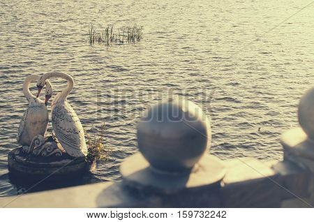 Statue of white swans as a symbol of loyalty and love.
