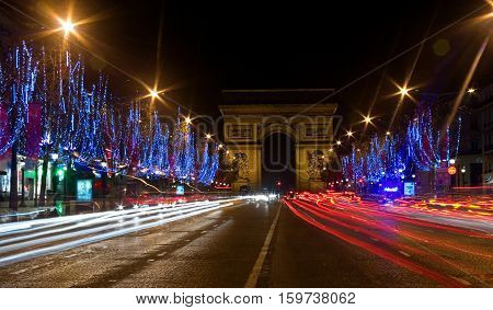 Night View Of The Champs-elysees With Christmas Illumintation And The Arc De Triomphe In Paris, Fran