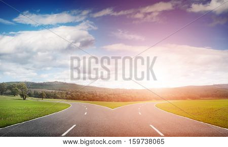 Natural landscape image of forked asphalt road