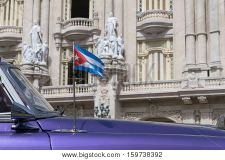 Cuban flag on a classic american car in Havana, Cuba