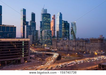 MOSCOW - APR 12, 2016: Moscow International Business Center (MIBC) and highway at evening. East tower of complex Federation in height 374 m - highest skyscraper in Europe