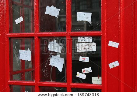 Fans of tv-series Sherlock BBC leave notes I believe in Sherlock Holmes on the phone box near the Saint-Bartholomew's hospital after fake Sherlock's suicide.