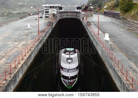 Carrapatelo Dam, Portugal, November 12, 2016: A tourist ship enters the lower level of the locks at the Carrapatelo Dam at the Douro river in Portugal.