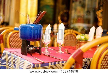 Parisian Street Cafe With An Earthenware Pot (caquelon) For Fondue