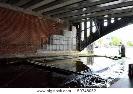 Tunnel with floodgate in a canal in Amsterdam
