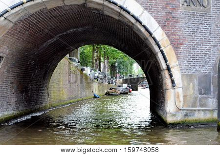 Old bridge in a canal in Amsterdam