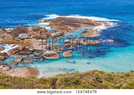 An outcrop of rocks near Lowlands Beach between the towns of Albany and Denmark in Western Australia.