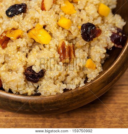 Quinoa Porridge with Pumpkin, Nuts and Dried Fruit. Selective focus.