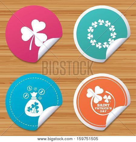 Round stickers or website banners. Saint Patrick day icons. Money bag with clover sign. Wreath of trefoil shamrock clovers. Symbol of good luck. Circle badges with bended corner. Vector