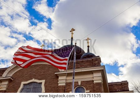God Bless America American flag and old church steeple reflect separation of church and state
