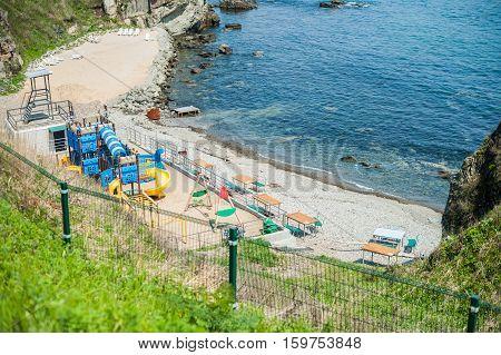 A Children's Playground On The Beach