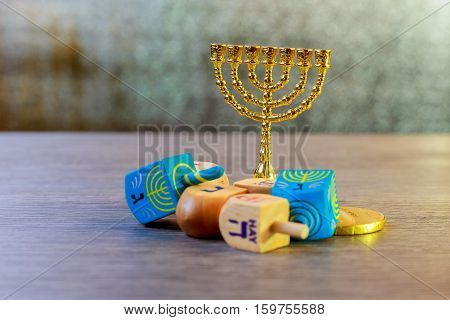Jewish Holiday Hanukkah With Wooden Dreidels Colection Spinning Top And Chocolate Coins On The Table