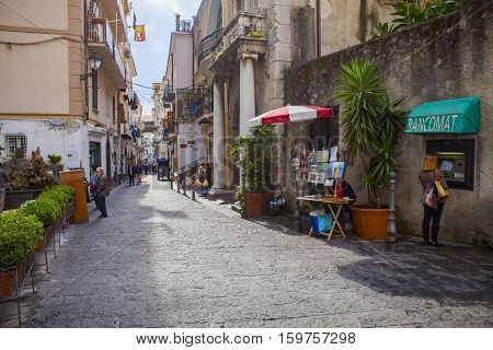 AMALFI ITALY - NOVEMBER 5 : tourist walking in narrow treet of amalfi town important traveling destination south mediterranean on november 5 2016 in amalfi town south italy