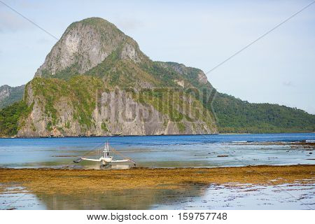 Beautiful Landscape With An Outrigger Boat On Palawan