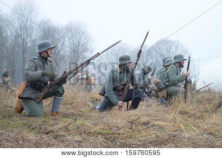 GATCHINA,  RUSSIA - NOVEMBER 07, 2015: The German infantrymen of the period of World War I before the attack. International military and historical festival