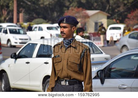 NEW DELHI, INDIA - FEBRUARY 02, 2016 - Portrait of an indian guard in uniform standing on the street