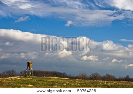 Hunting watchtower on a meadow at sunny autumn day, Deliblatska pescara, Serbia