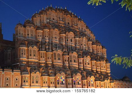Wind Palace (Hawa Mahal) and its windows at night in Jaipur, Rajasthan, India