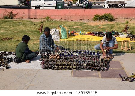 JAIPUR, RAJASTHAN, INDIA - FEBRUARY 05, 2016 - Indian guys selling shoes
