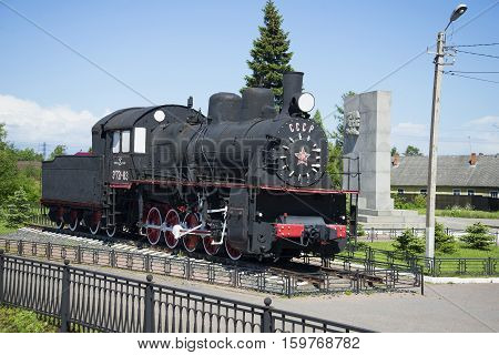 LENINGRAD REGION, RUSSIA - JUNE 08, 2015: Memorial steam locomotive Em 721-83 mounted on the station Petrokrepost. The tourist landmark