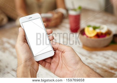 Close Up Shot Of Man's Hands Holding Cell Phone With Blank Copy Space Screen For Your Text. Caucasia
