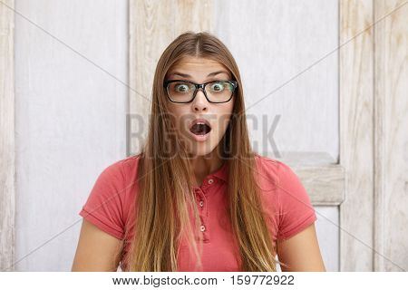 Wide-eyed Female Student With Long Fair Hair Having Surprised And Forgetful Look. Young Woman Custom