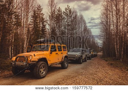 Karelia, Russia, May 3 2016 Jeep Wrangler leaving the club at the mountain Vottovaara, the Jeep Wrangler is a compact four wheel drive off road and sport utility vehicle