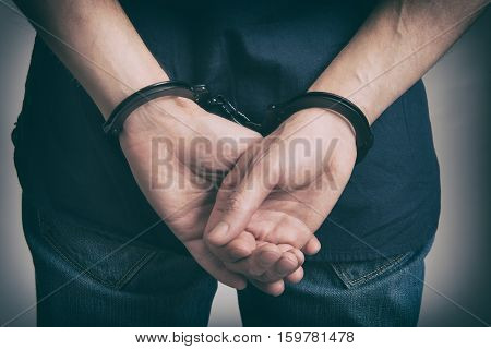 Arrested Man In Handcuffs With Hands Behind Back