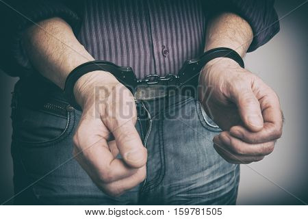 Male Hands Handcuffed
